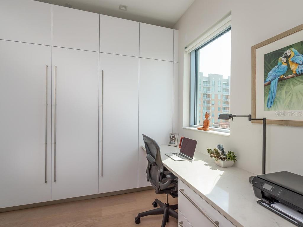 Sleek and modern Chef's Kitchen with a convenient walk in pantry and convenient built-in desk. - Condo for sale at 1301 Main St #1001, Sarasota, FL 34236 - MLS Number is A4402790