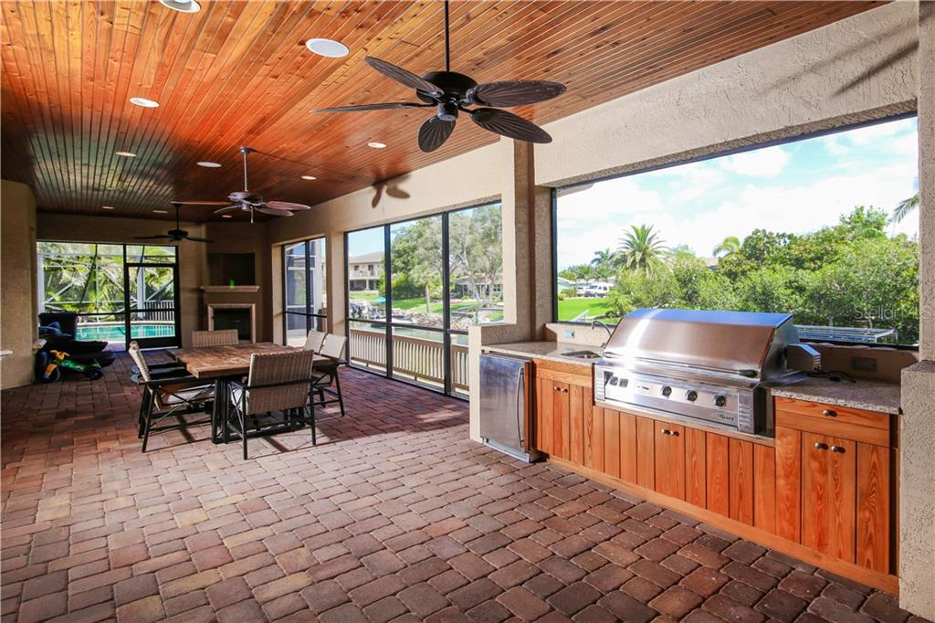 50' screened in Laini with outdoor Kitchen - Single Family Home for sale at 432 Sorrento Dr, Osprey, FL 34229 - MLS Number is A4402898