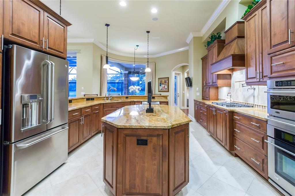 State of the art chef's kitchen with wood cabinets and miles of counter space makes meal preparation a snap. - Single Family Home for sale at 12312 Newcastle Pl, Lakewood Ranch, FL 34202 - MLS Number is A4403090