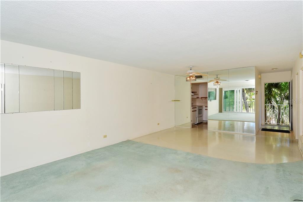 Looking from living room back to dining area/kitchen and front door...note terrazzo exposed in these areas - Condo for sale at 500 S Washington Dr #3b, Sarasota, FL 34236 - MLS Number is A4403390