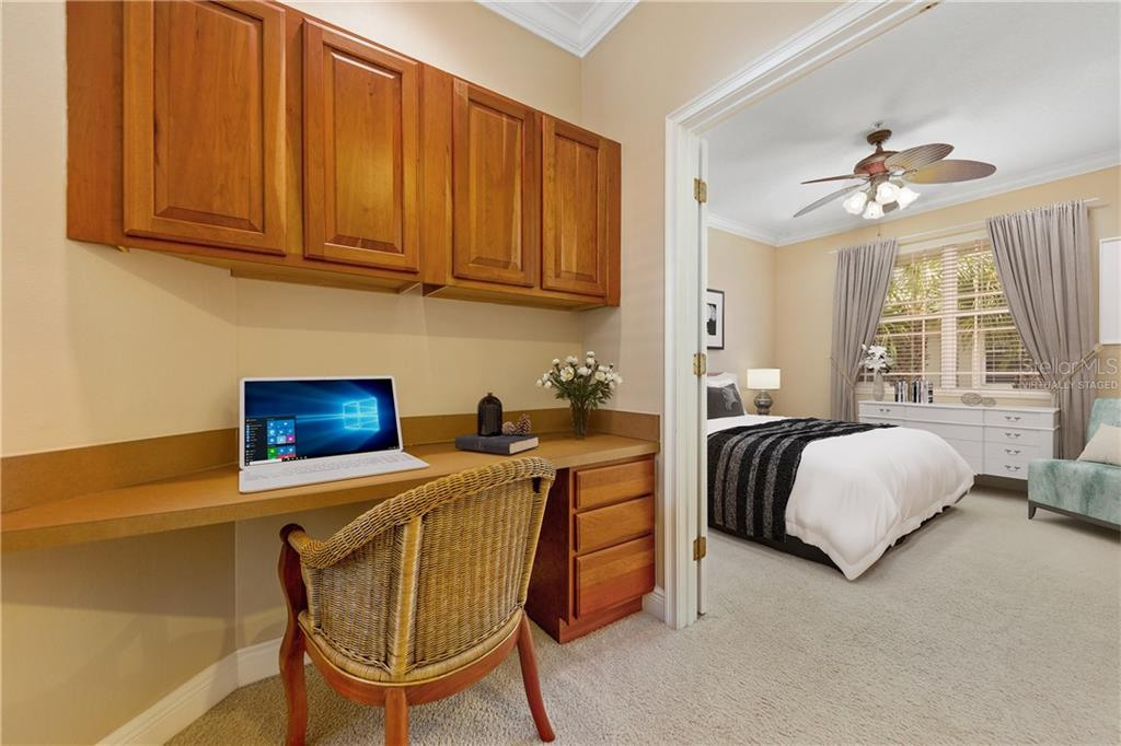 Virtually staged.  Desk area and entry to flex room set up as a bedroom option. - Condo for sale at 6540 Moorings Point Cir #202, Lakewood Ranch, FL 34202 - MLS Number is A4403403