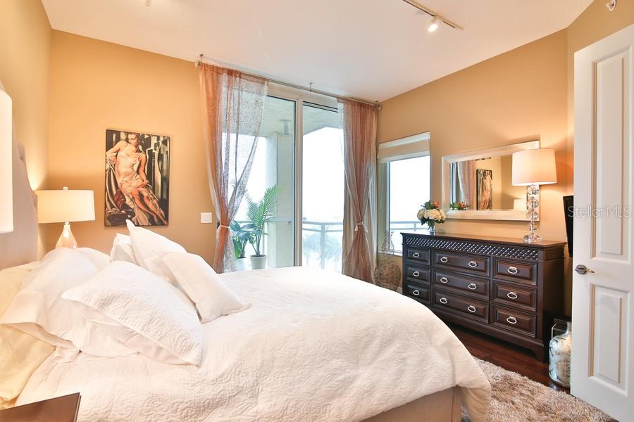 Den with closet and Sliding door to balcony, being used as a third bedroom. - Condo for sale at 1300 Benjamin Franklin Dr #507, Sarasota, FL 34236 - MLS Number is A4403882