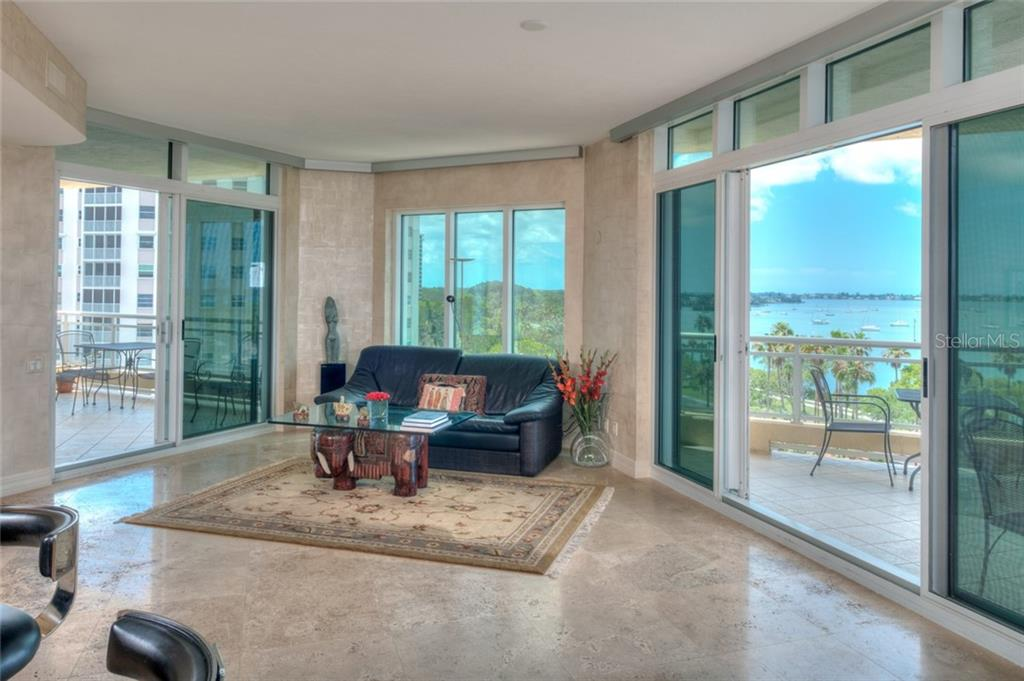 Family room framed in outdoor living balconies. - Condo for sale at 340 S Palm Ave #412, Sarasota, FL 34236 - MLS Number is A4403968