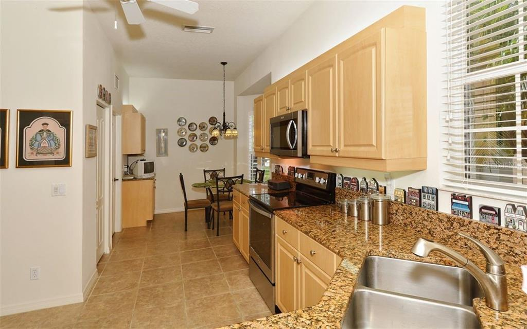 Kitchen - Villa for sale at 1647 Lancashire Dr #1647, Venice, FL 34293 - MLS Number is A4404210