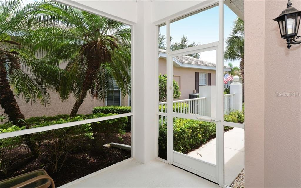 Front porch - Villa for sale at 1647 Lancashire Dr #1647, Venice, FL 34293 - MLS Number is A4404210