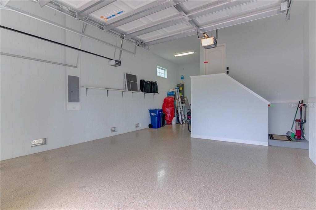 Tandem 3 car garage, epoxy floor, high ceiling offers lots of space for storage. - Single Family Home for sale at 8139 37th Avenue Cir W, Bradenton, FL 34209 - MLS Number is A4404272