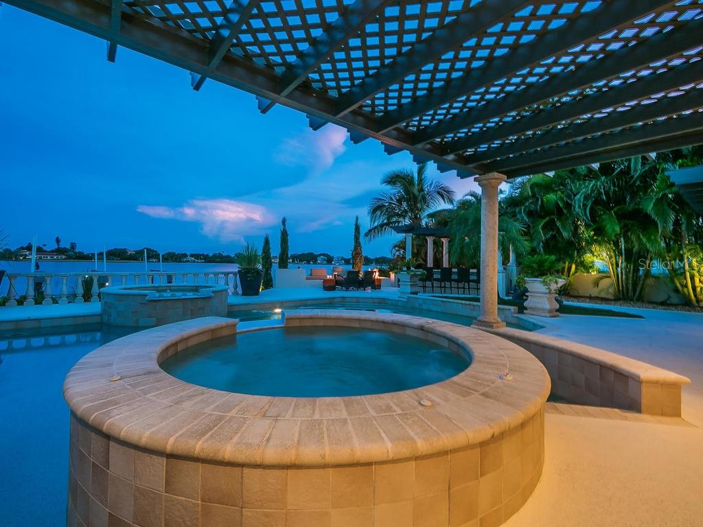 Grand pool and spa with plenty of additional outdoor space. - Single Family Home for sale at 301 Bayview Pkwy, Nokomis, FL 34275 - MLS Number is A4405265