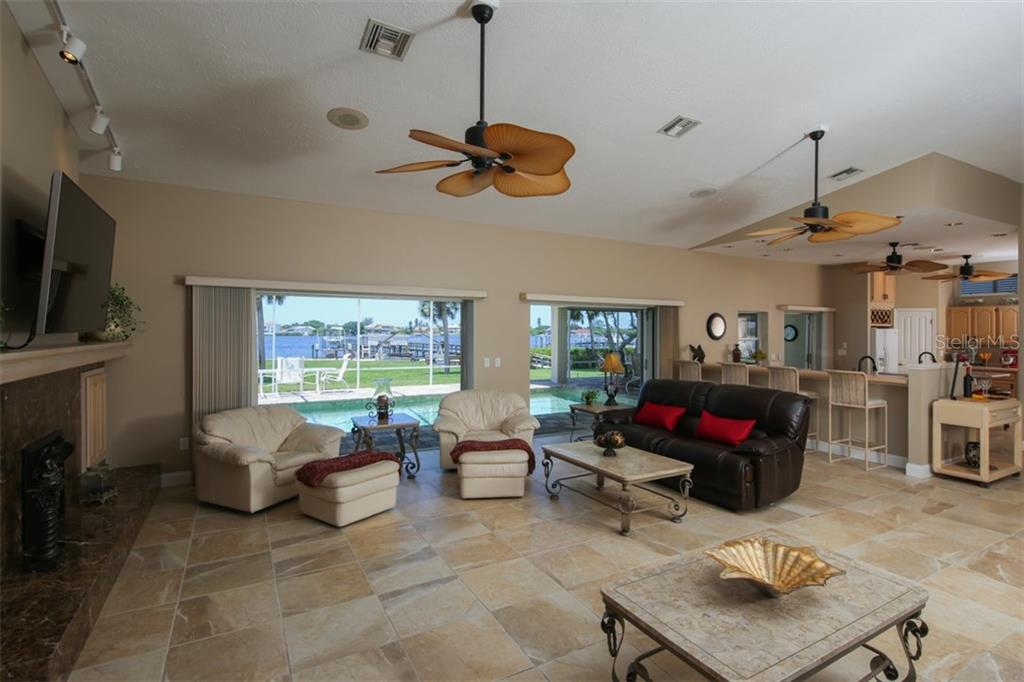 Bay views and pocketing sliders ideal for social gatherings - Single Family Home for sale at 1778 Bayshore Dr, Englewood, FL 34223 - MLS Number is A4405962