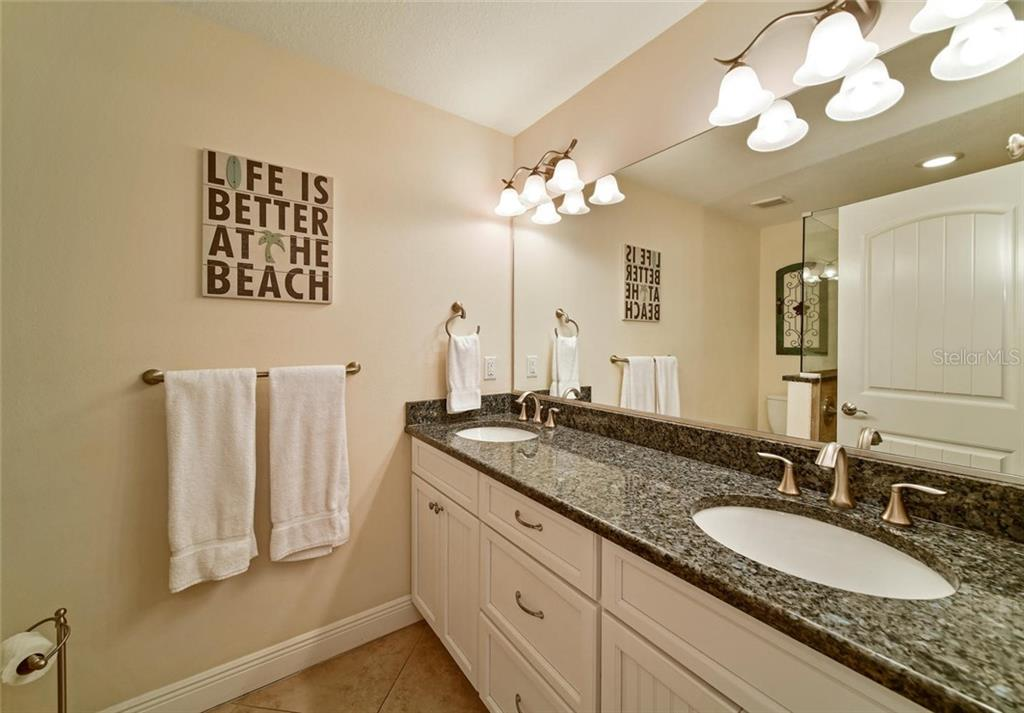 The master bath boasts granite counters and lots of drawer and cabinet space. - Single Family Home for sale at 113 36th St, Holmes Beach, FL 34217 - MLS Number is A4407267