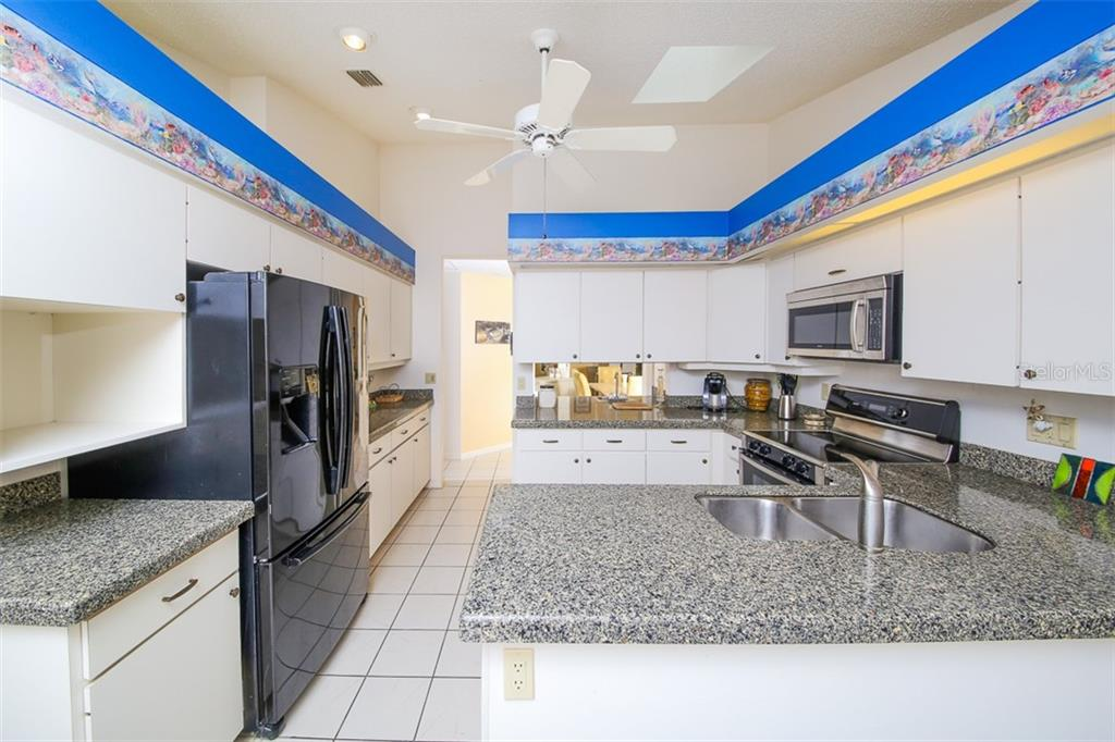 Large Kitchen with Ceiling Fan - Villa for sale at 4472 Calle Serena, Sarasota, FL 34238 - MLS Number is A4407721
