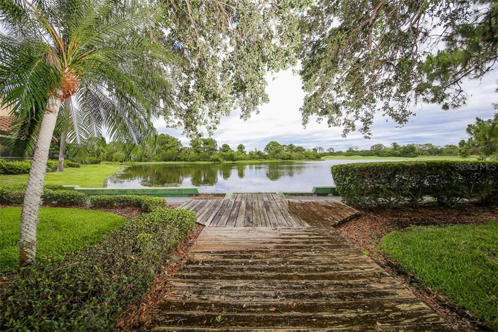 Walking Path to Lake - Villa for sale at 4472 Calle Serena, Sarasota, FL 34238 - MLS Number is A4407721