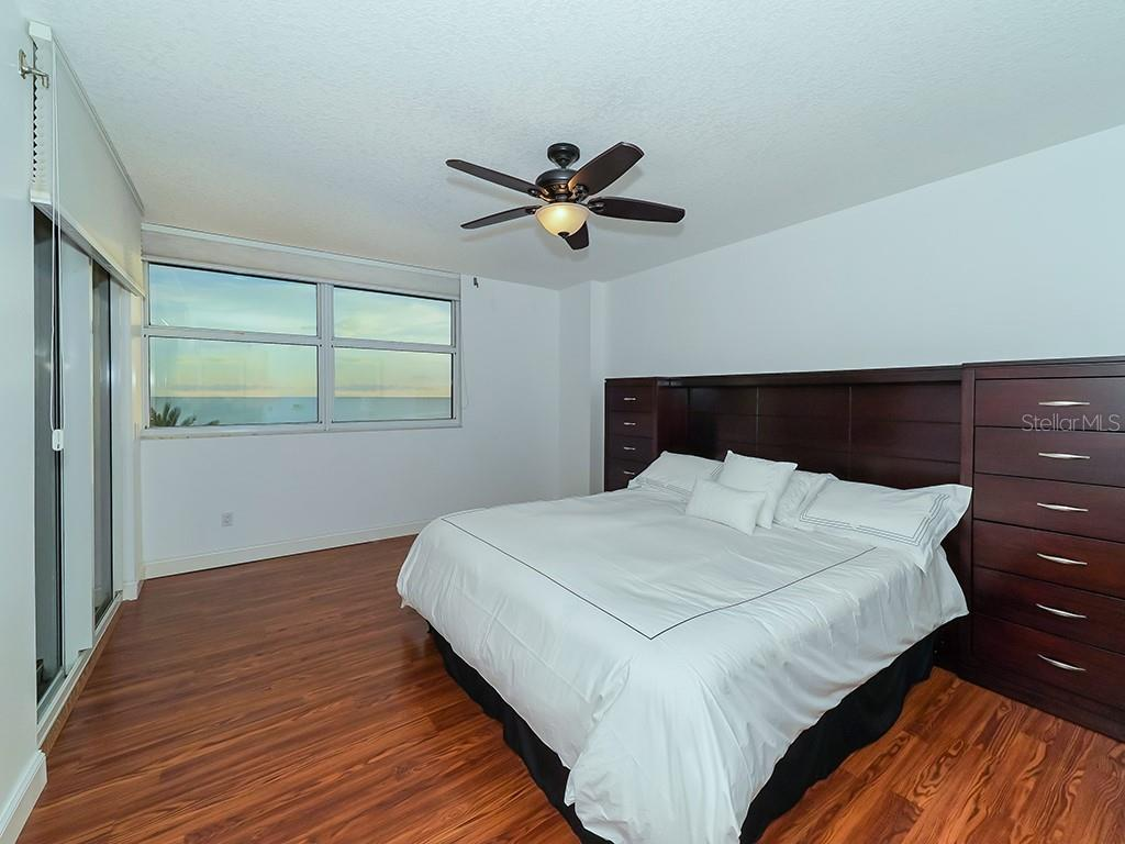 Master Bedroom - Access to Gulf Terrace - Condo for sale at 1800 Benjamin Franklin Dr #b409, Sarasota, FL 34236 - MLS Number is A4408201