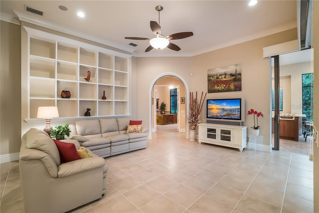Family Room - archway leads to Den/Office and a Guest Bedroom. - Single Family Home for sale at 13223 Palmers Creek Ter, Lakewood Ranch, FL 34202 - MLS Number is A4408290