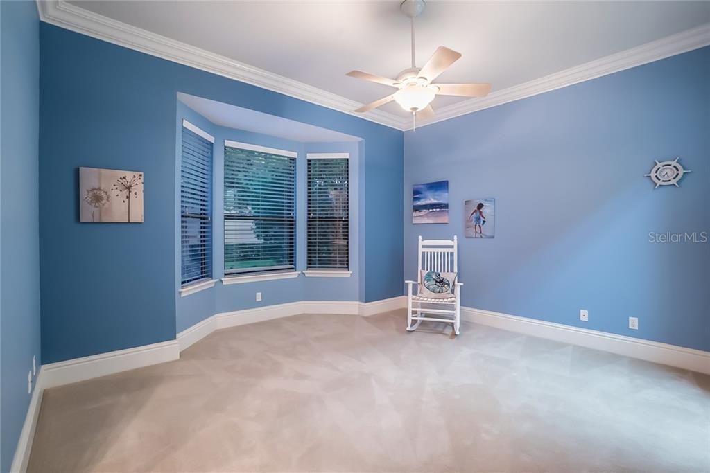 Guest Bedroom (2) with a walk-in closet. A Jack & Jill Bathroom adjoins. - Single Family Home for sale at 13223 Palmers Creek Ter, Lakewood Ranch, FL 34202 - MLS Number is A4408290