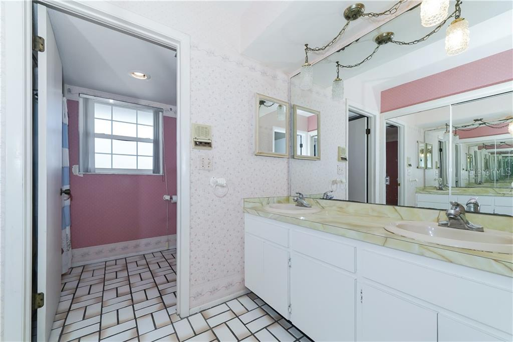Master bathroom with dual sinks - Single Family Home for sale at 5591 Cape Aqua Dr, Sarasota, FL 34242 - MLS Number is A4411099