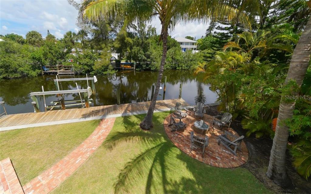 View from the Master bedroom rear deck.  Notice the secondary outdoor area for watching Siesta sunsets down the canal..... - Single Family Home for sale at 138 Island Cir, Sarasota, FL 34242 - MLS Number is A4412265