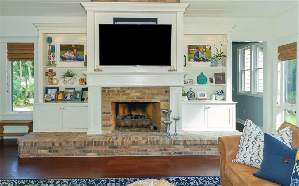 Redesigned entertainment wall and bricked fireplace and hearth - Single Family Home for sale at 3183 Dick Wilson Dr, Sarasota, FL 34240 - MLS Number is A4412326