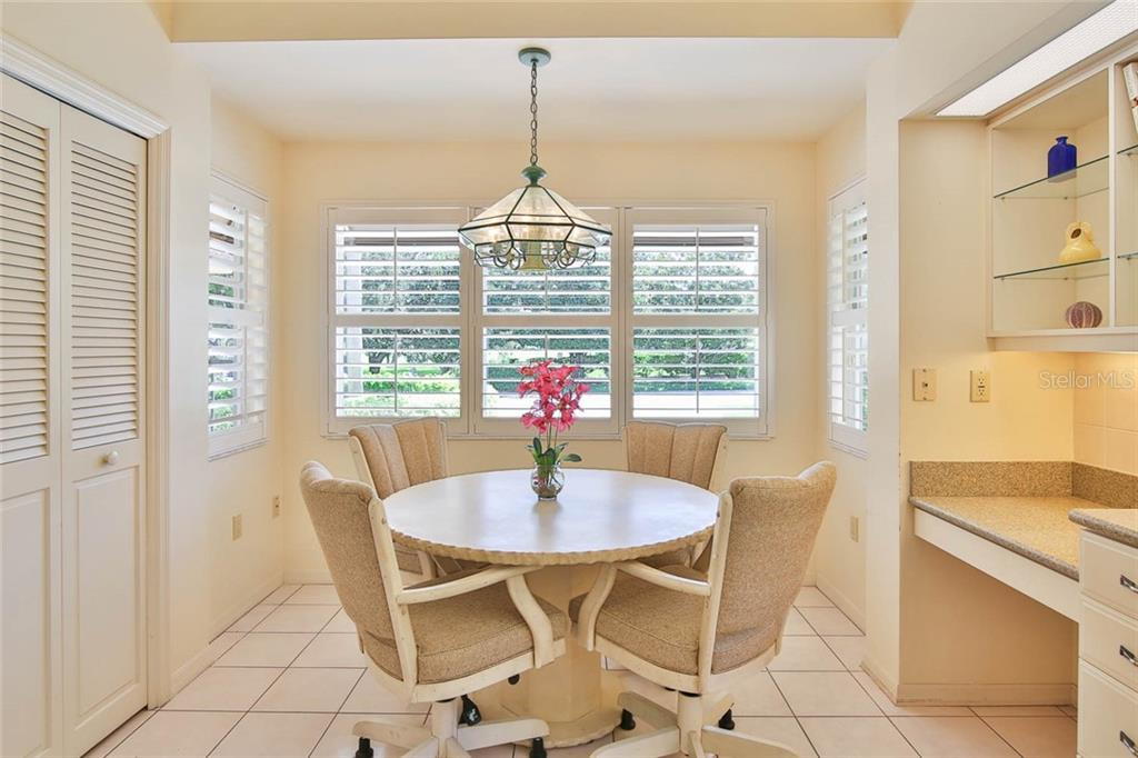 Eat-in area in the kitchen.  Nice and light and bright. - Villa for sale at 7686 Calle Facil, Sarasota, FL 34238 - MLS Number is A4413755