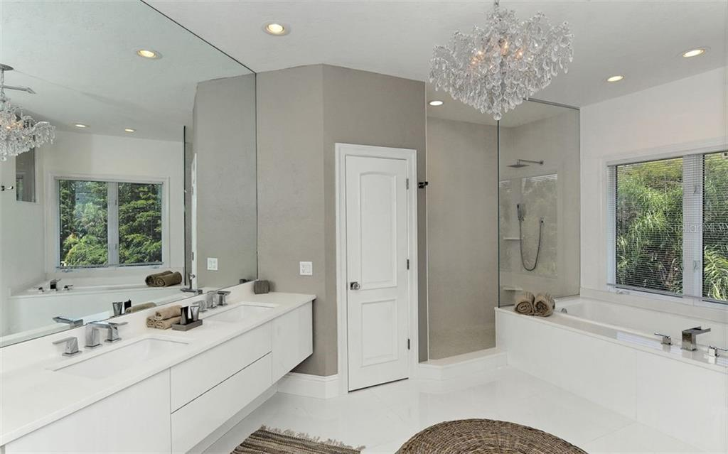 Master bath features dual sinks, garden tub, walk-in shower & private commode. - Single Family Home for sale at 2145 Alameda Ave, Sarasota, FL 34234 - MLS Number is A4414337