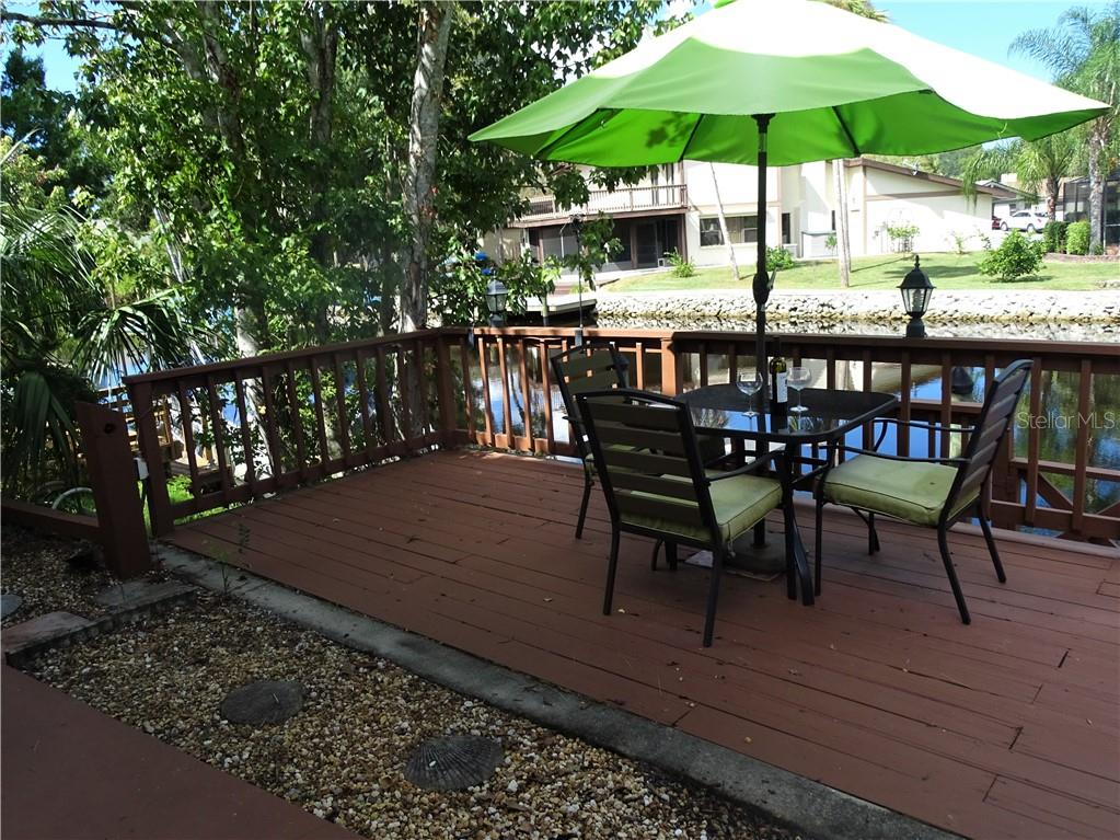 Enjoy your morning coffee or evening cocktail in this lovely, shaded spot. - Single Family Home for sale at 5214 S Riverview Cir, Homosassa, FL 34448 - MLS Number is A4414387