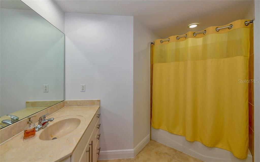 Guest Bath - Condo for sale at 1771 Ringling Blvd #1011, Sarasota, FL 34236 - MLS Number is A4414630