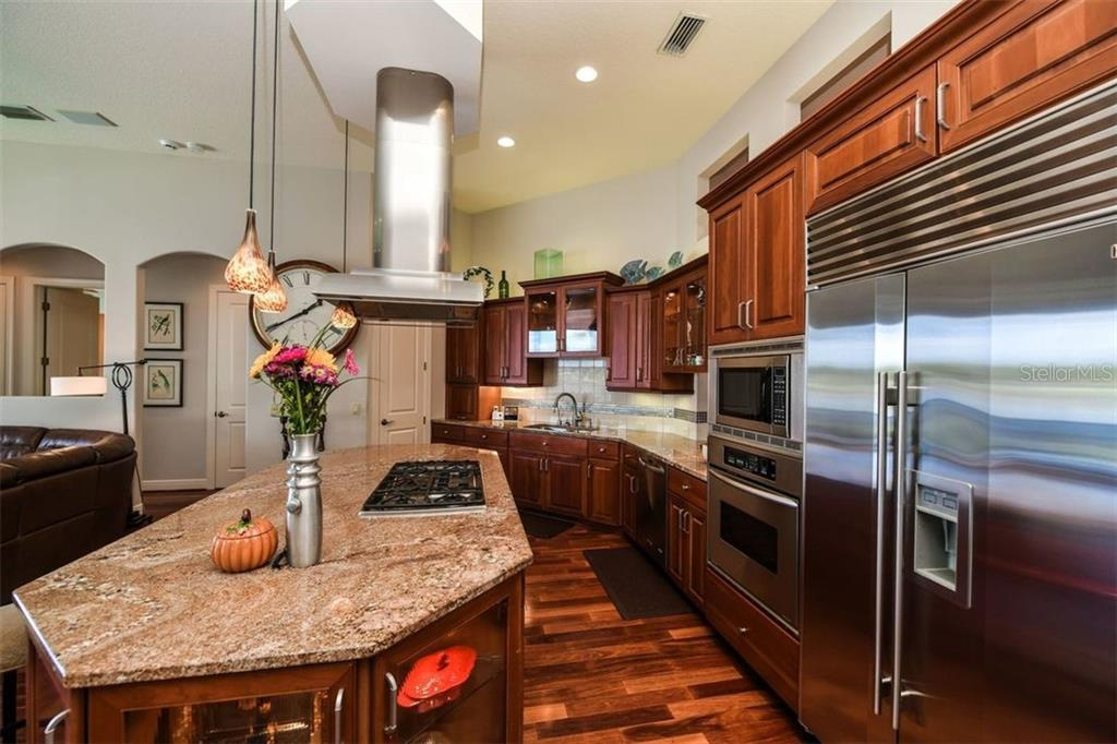 Open kitchen makes entertaining a joy.  Gas stovetop, Subzero refrigerator, instant hot water, all high end appliances. - Single Family Home for sale at 1483 Tangier Way, Sarasota, FL 34239 - MLS Number is A4414757