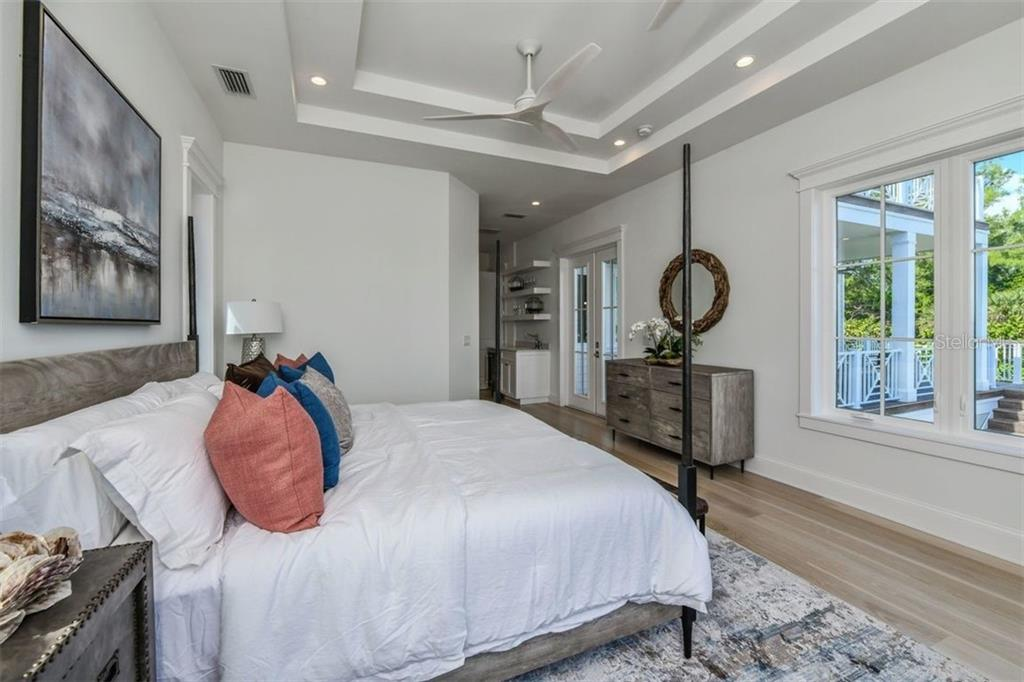 Master bedroom suite overlooking the pool and Sarasota Bay with mini-bar, walk in closet and master bathroom. - Single Family Home for sale at 3470 Gulf Of Mexico Dr, Longboat Key, FL 34228 - MLS Number is A4415298