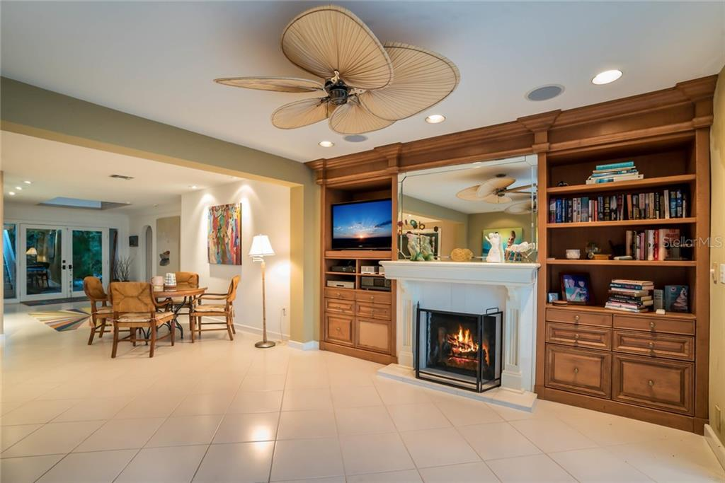 Living room fireplace - Single Family Home for sale at 230 N Washington Dr, Sarasota, FL 34236 - MLS Number is A4415745
