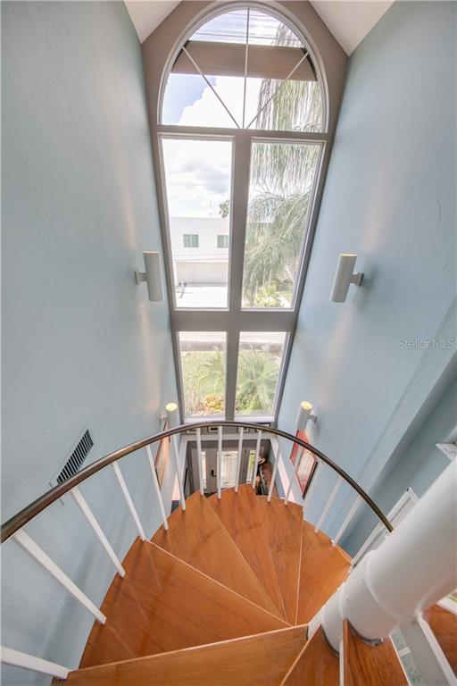 It's like a painting! From the top of the 3rd floor stairwell, looking out those gorgeous windows and down to the leaded glass front door. - Single Family Home for sale at 660 Marbury Ln, Longboat Key, FL 34228 - MLS Number is A4415911