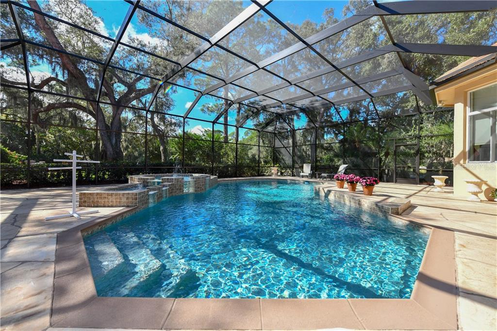 Caged and Propane heated Pool - Single Family Home for sale at 7659 Alister Mackenzie Dr, Sarasota, FL 34240 - MLS Number is A4416607