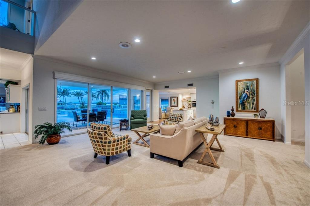 Sunset living room views. - Single Family Home for sale at 7689 Cove Ter, Sarasota, FL 34231 - MLS Number is A4417242