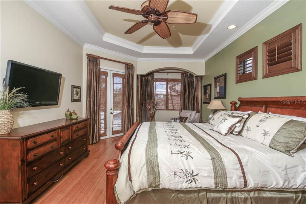 Owner's Suite Opens to Lanai - Single Family Home for sale at 7060 Whitemarsh Cir, Lakewood Ranch, FL 34202 - MLS Number is A4417363