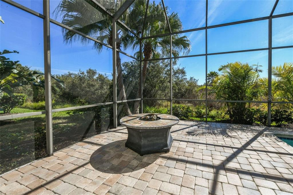 Expanded Lanai with Fire Pit Overlooks Estuary - Single Family Home for sale at 7060 Whitemarsh Cir, Lakewood Ranch, FL 34202 - MLS Number is A4417363