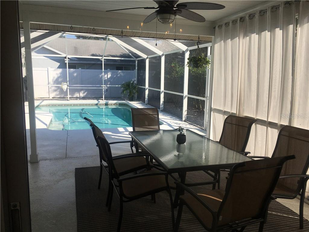 Protected patio area with solar heated screened pool. - Single Family Home for sale at 1611 82nd St Nw, Bradenton, FL 34209 - MLS Number is A4417607