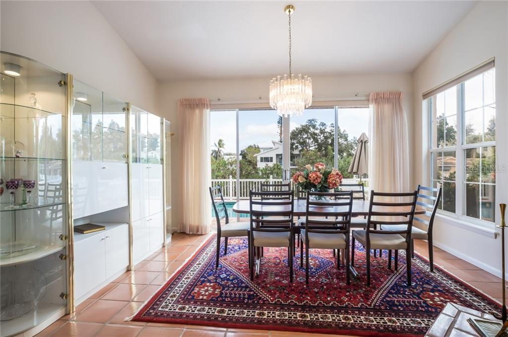 dining room with beautiful view overlooking pool and canal - Single Family Home for sale at 4963 Oxford Dr, Sarasota, FL 34242 - MLS Number is A4417783