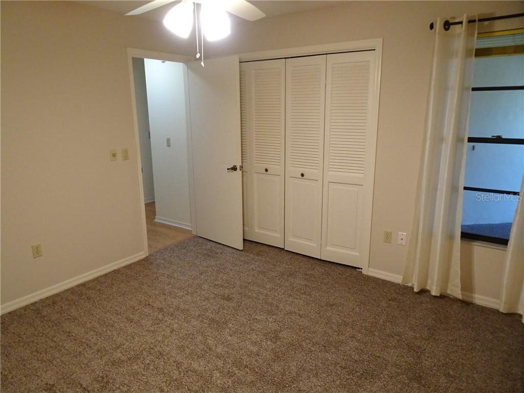 Guest bedroom with new carpet and fresh paint. - Villa for sale at 3617 Gleneagle Dr, Sarasota, FL 34238 - MLS Number is A4417832