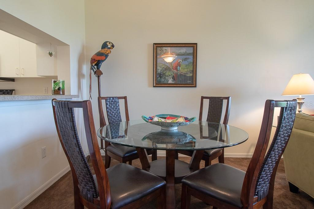 Dining area with pass through to kitchen - Condo for sale at 9620 Club South Cir #5110, Sarasota, FL 34238 - MLS Number is A4418081