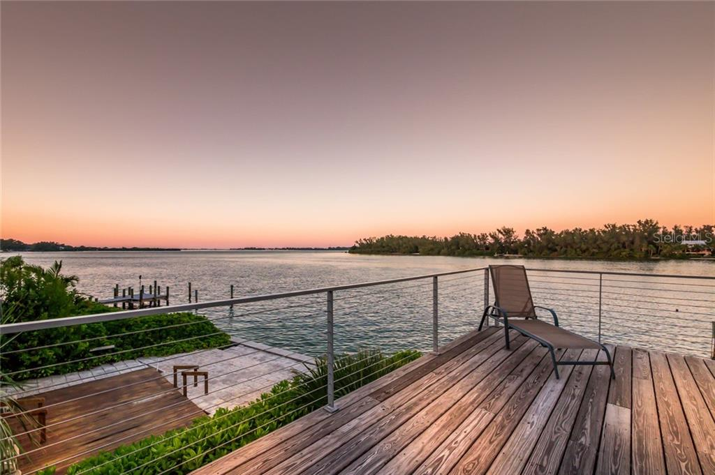 Back deck views at twilight - Single Family Home for sale at 7130 Longboat Dr E, Longboat Key, FL 34228 - MLS Number is A4418105