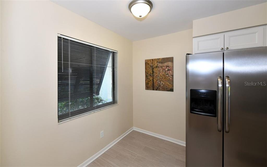 Plenty of space for Bistro Table or Desk/Work space - Condo for sale at 4576 Longwater Chase #59, Sarasota, FL 34235 - MLS Number is A4418168