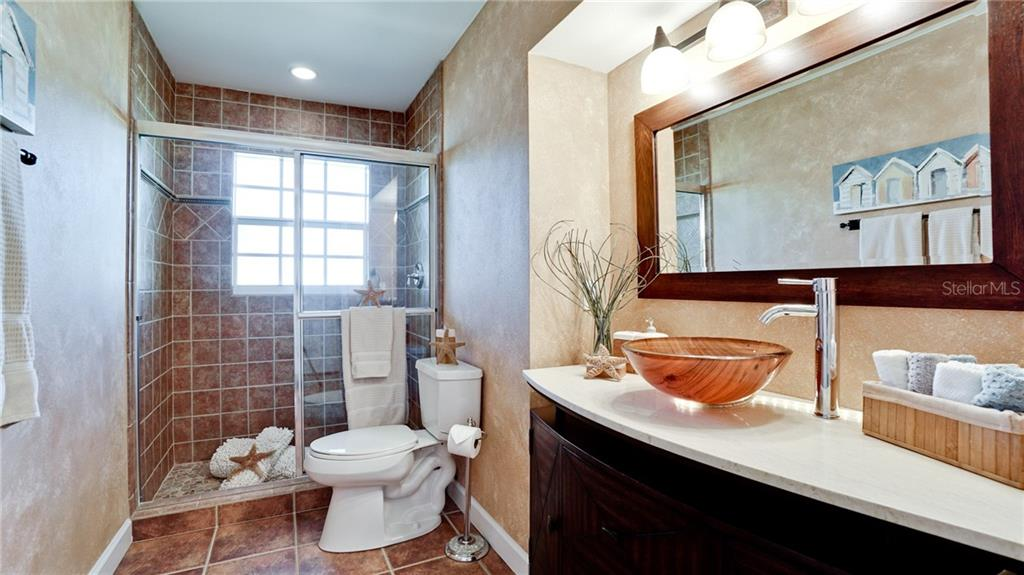 Guest bath room - Single Family Home for sale at 612 Ambassador Ln, Holmes Beach, FL 34217 - MLS Number is A4418766