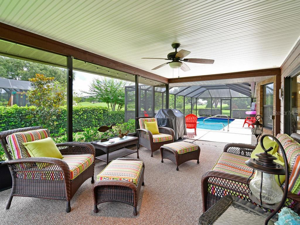 Newly remodeled covered and screened lanai is great spot to relax and watch the water birds on the lake. - Single Family Home for sale at 9902 Braden Run, Bradenton, FL 34202 - MLS Number is A4419792