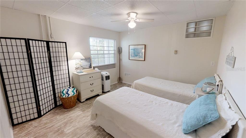 First floor bedroom with maintenance free flooring - Single Family Home for sale at 521 75th St, Holmes Beach, FL 34217 - MLS Number is A4420243