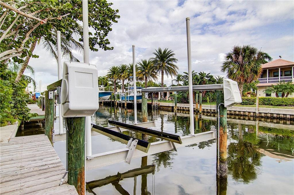 The boat lift was recently serviced and can be adjusted for your needs - Single Family Home for sale at 521 75th St, Holmes Beach, FL 34217 - MLS Number is A4420243
