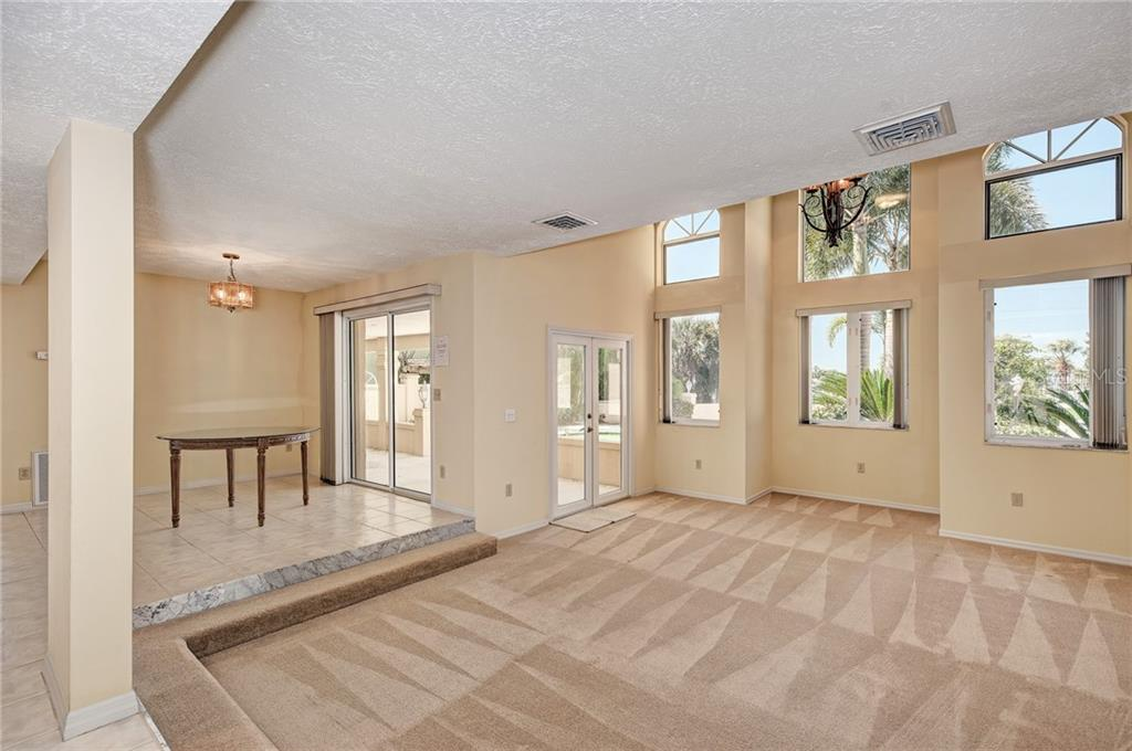 FOYER & LIVING ROOM - Single Family Home for sale at 5110 Sun Cir, Sarasota, FL 34234 - MLS Number is A4420424