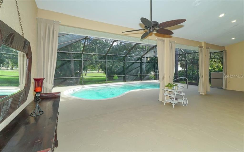 Screen enclosed pool area & lanai. Recessed lighting, ceiling fans & full pool bath. - Single Family Home for sale at 6125 Varedo Ct, Sarasota, FL 34243 - MLS Number is A4420656