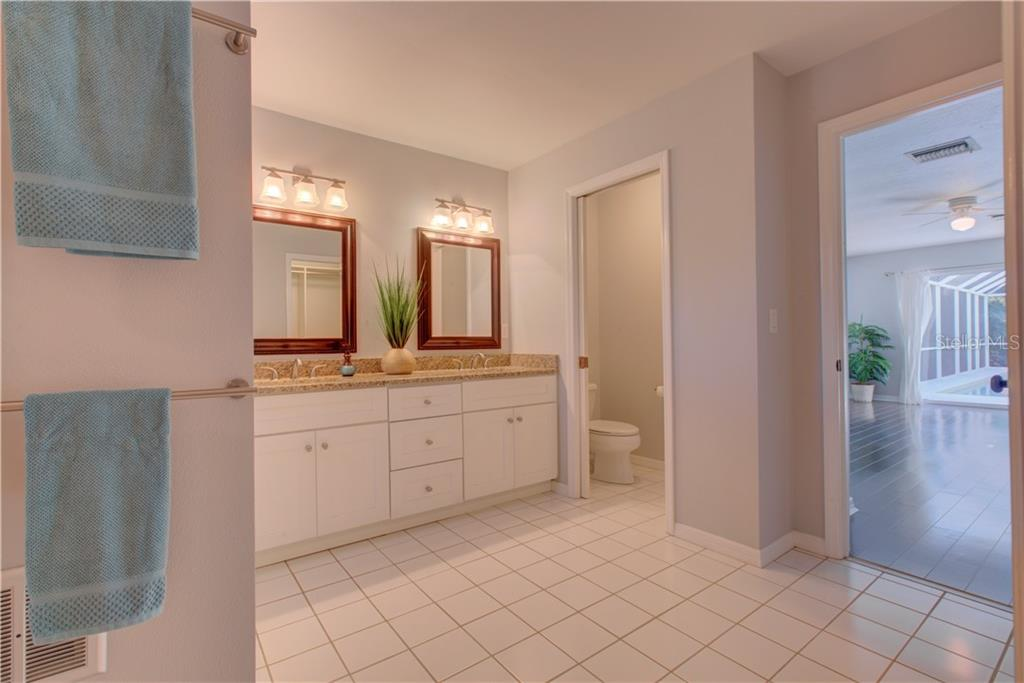 Master bathroom looking back through to the master bed - Single Family Home for sale at 5167 Kestral Park Ln, Sarasota, FL 34231 - MLS Number is A4421162