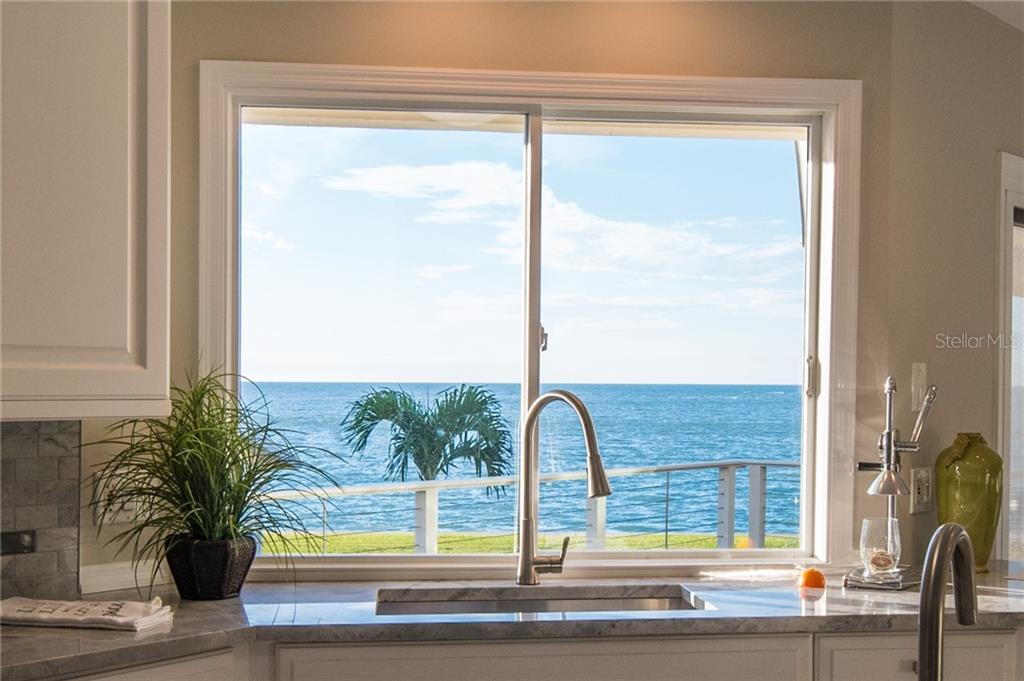 Kitchen window with view. - Single Family Home for sale at 108 Sand Dollar Ln, Sarasota, FL 34242 - MLS Number is A4421218