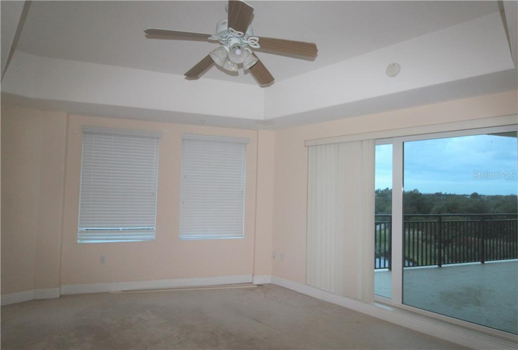Master Bedroom with Balcony - Condo for sale at 501 Haben Blvd #504, Palmetto, FL 34221 - MLS Number is A4421758