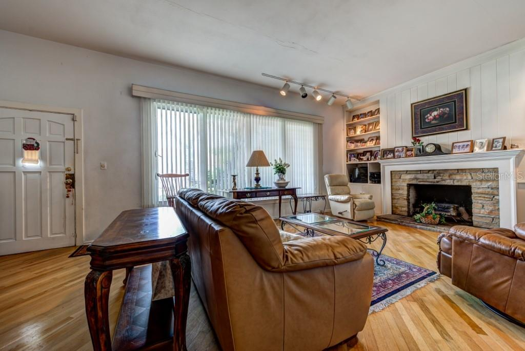High ceilings, plaster interior walls, rich wood floors and the wood burning fireplace welcome you home. - Single Family Home for sale at 1509 Flower Dr, Sarasota, FL 34239 - MLS Number is A4421898
