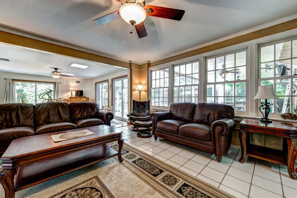 The Florida room has non stop views of the lanai, pool and rear yard. - Single Family Home for sale at 1509 Flower Dr, Sarasota, FL 34239 - MLS Number is A4421898